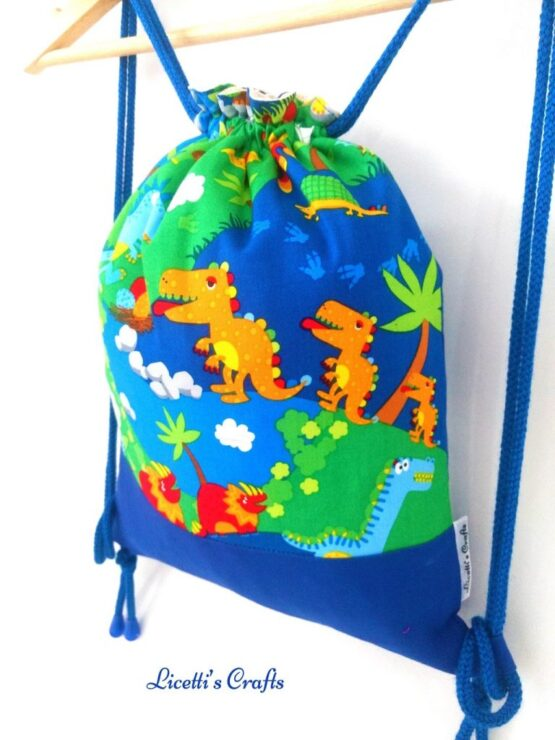 detalle mochila cuerdas hecha a mano dinosaurios