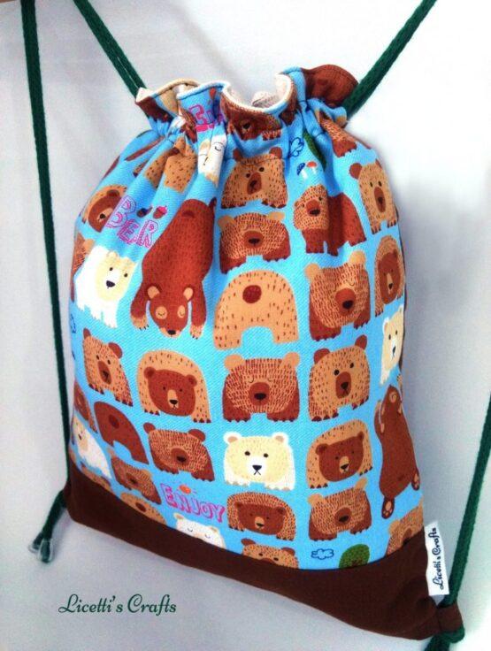 Detalle mochila cuerdas con tejido de osos