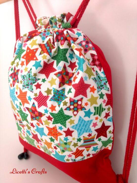 detalle mochila cuerdas forro algodón estrellas navidad