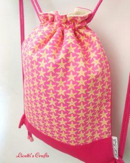 detalle mochila cuerdas forro algodón estrella de mar rosa