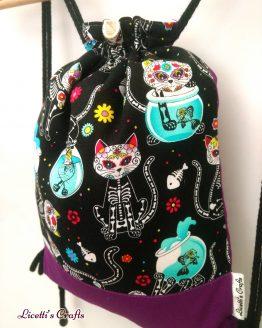 detalle mochila cuerdas forro algodón gato calavera