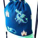 mochila cuerdas infantil dragón castillo